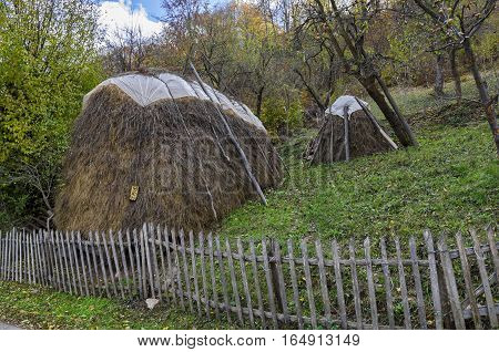 Pastoral landscape in garden with bundle of hay, Lakatnik,  Bulgaria