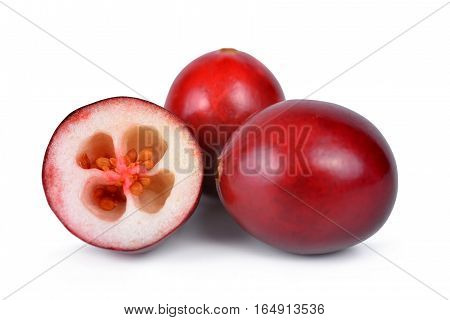The tasty american cranberries ( Vaccinium macrocarpon ) isolated on white background.
