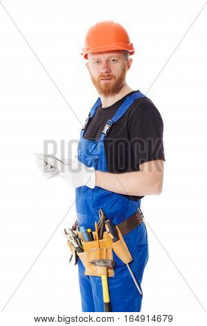 Man Builder In The Uniform With A Tablet In The Hands