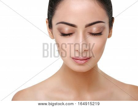 Beautiful thoughtful indian girl face with closed eyes, perfect skin make up closeup. Beauty and health care. Ideal portrait of brunette, isolated on white background