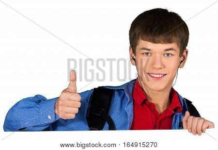 Teen male preppy with headphones giving thumbs up behind invisible sign