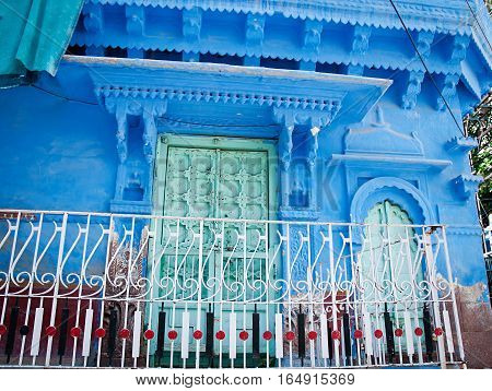 Old wood doors with blue wall. Jodhpur Rajasthan Iindia;