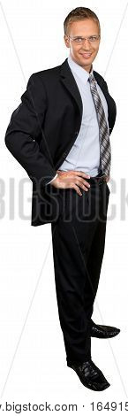 Businessman standing with his hands on his hips