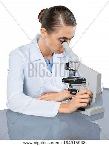 Female Scientist / Researcher / Doctor Using Microscope