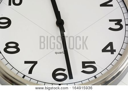 Classic clock close up with roman numbers