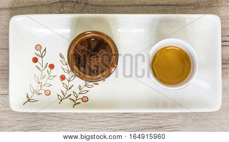 aerial view of a cip of coffee and a chocolate jar