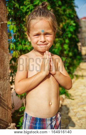 Very beautiful boy as a Buddha with a third eye
