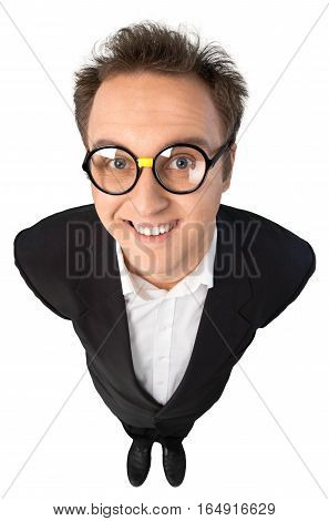 Young Man With Glasses In Suit Standing With Hands Behind Back Top-down View - Isolated