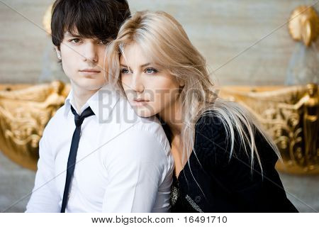 couple - girl and guy near the wall