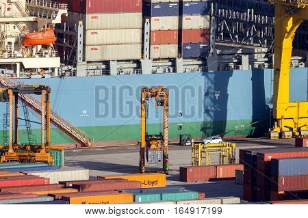 BARCELONA SPAIN - MAY 21 2016: Ship being loaded in the container terminal from the Port of Barcelona.