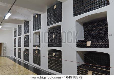 RUSSIA, CRIMEA, YALTA - may 29.2014:  Shelves with bottles of wine in the cellar of the Massandra winery