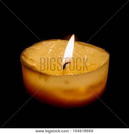 Lonely candle is burning in the dark