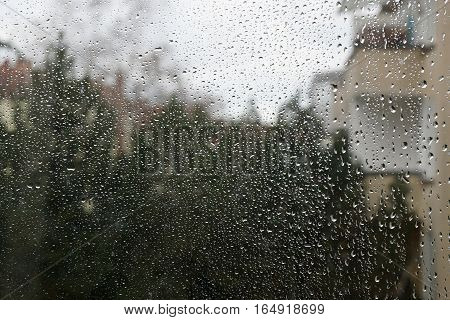 raindrops on window pane background. bad weather. rainy day.