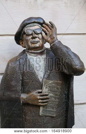 STOCKHOLM SWEDEN - AUGUST 19 2016: Evert Taube Monument (1890-1976) one of the famous Swedish composerswriters and actors located on Järntorget Gamla Stan in Stockholm Sweden on August 19 2016.