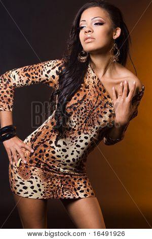 fashionable mulatto woman on orange