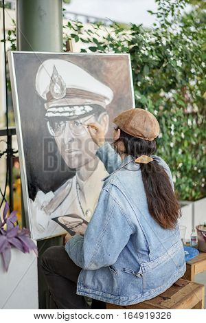 artist painting King Rama 9 ,Bangkok,Thailand ,January 1,2017