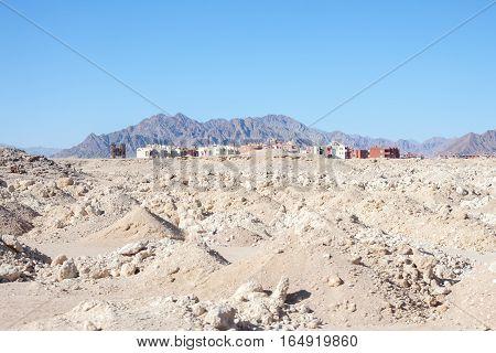 abandoned unfinished houses in Egyptian desert Sharm El Sheikh