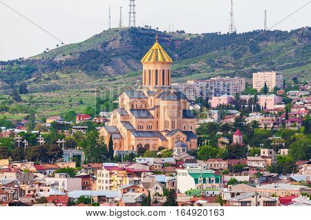 Panoramic view of the city with St. Trinity cathedral in Tbilisi, capital of Republic of Georgia