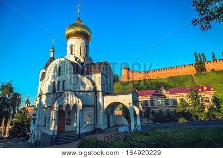NIZHNY NOVGOROD RUSSIA - June 1 2016: Church of the Kazan Icon of the Mother of God and Kremlin in Nizhny Novgorod Russia