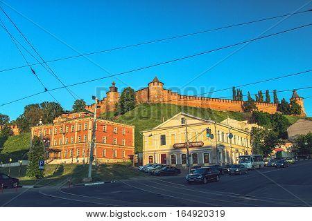 NIZHNY NOVGOROD RUSSIA - June 1 2016: View of Clock Tower and North Tower of Kremlin in Nizhny Novgorod. Bottom view from Square of the Popular Unity