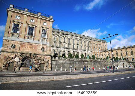 STOCKHOLM SWEDEN - AUGUST 19 2016: Pedestrian walk near The Royal Palace. Stockholm Royal Palace is major royal palace of Swedish monarch in Stockholm Sweden on August 19 2016.