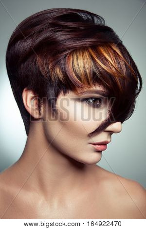 Fashion portrait of a beautiful girl with colored dyed hair, professional short hair coloring. studio shot. poster