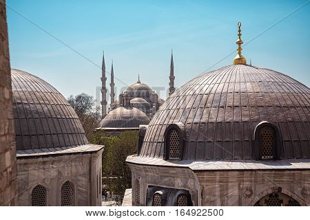 ISTANBUL, TURKEY - APRIL 15, 2015 :The Blue Mosque in the Sultanahmet district of Istanbul in Turkey. Viewed from across the rooftops of the Hagia Sophia Mosque.