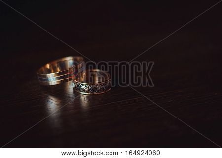 gold wedding rings on the pincushion. Wedding rings.