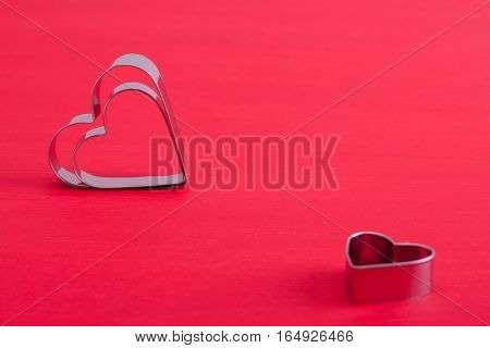 Valentine Background With Metal Hearts On Pink Wood.
