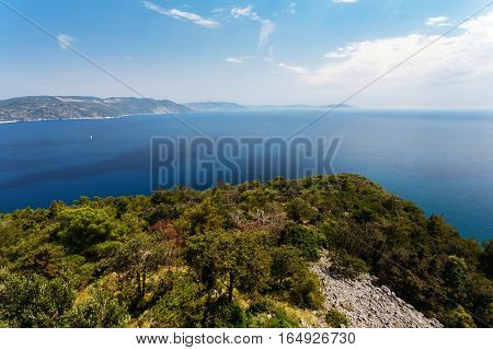 Top view of the sea strait or bay without boats and people from the restaurant Vidicovac. Quiet, calm. Croatia, Plomin.