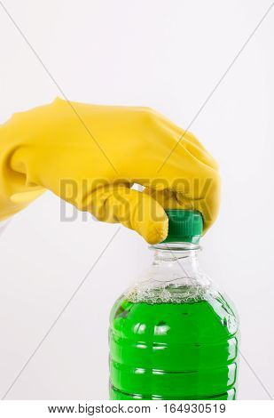 Hand Opening Bottle Of Cleaning Liquid