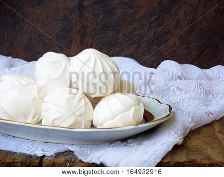 Sweet White Russian Marshmallow, Chocolate Zephyr, Meringue On Wooden Background. Selective Focus