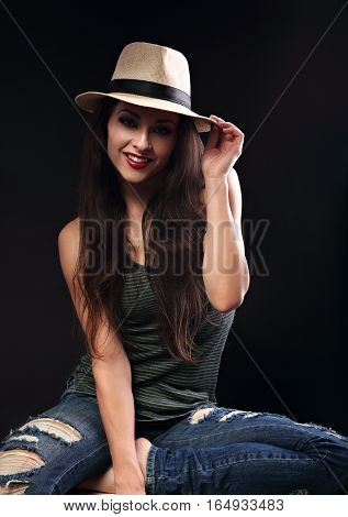 Beautiful Happy Female Model With Long Brown Hair Posing In Cowboy Hat And Fashion Green Top On Dark