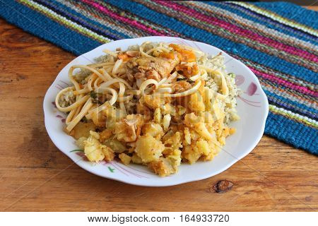 Typical Peruvian Andean meal of rice potatoes noodles and chicken