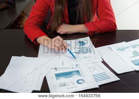 Businesswoman Hand Working With Business Graph Or Analysis Chart. Close Up Business Team Analysis An