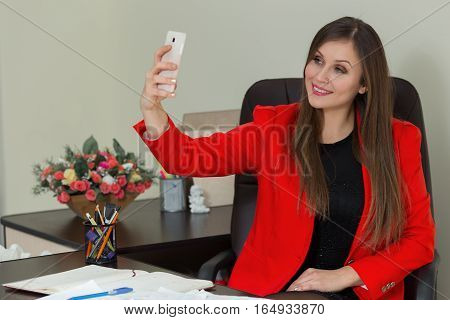 Young Beautiful Business Woman Make Selfie In Office.