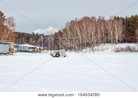 The river Split the Town of Berdsk Novosibirsk oblast Siberia Russia - January 12 2017: the snowy river and boat station