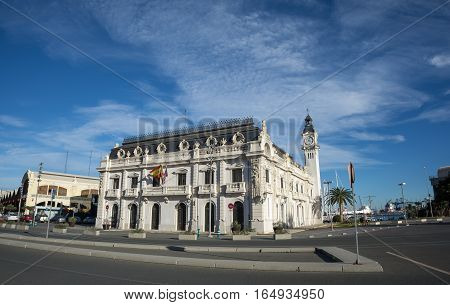 Port Authority buildings with clock tower in Valencia harbor, Spain, wide angle