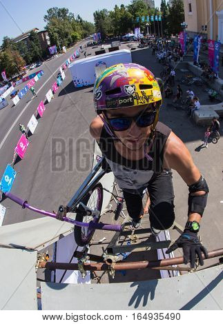 KAZAKHSTAN ALMATY - AUGUST 28, 2016: Urban extreme competition, where the city athletes compete in the disciplines: skateboard, roller skates, BMX. Bmx stunt performed at the top of a mini ramp on a skatepark.
