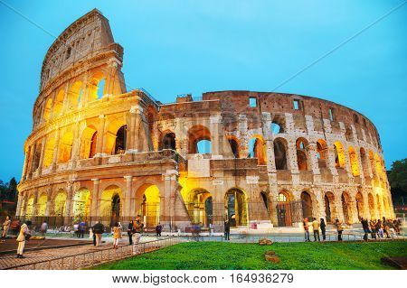 ROME - NOVEMBER 08: The Colosseum or Flavian Amphitheatre with people at night on November 8 2016 in Rome Italy.