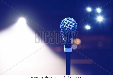 microphone on the background of dark hall and soffits. Soft focus selective focus