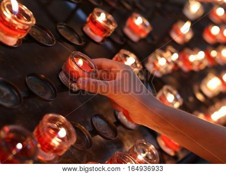 Hand Of Child Turns On A Candle In Church And Then She Says A Pr