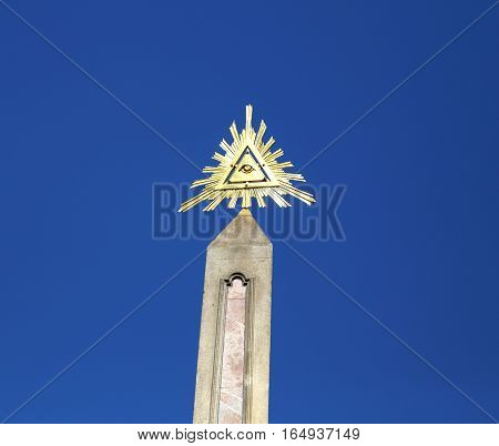Obelisk and the symbol of the trinity with triangle and one big Eye of Providence