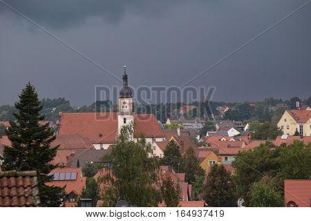 Hilpoltstein With Catholic Parish Church St. Johann Baptist Under Stormy Sky