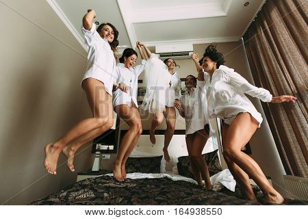 Emotional Girls With A Bride Jump On The Bed