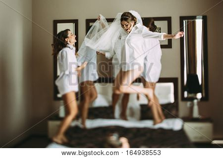 Girls are going crazy on the bed before wedding