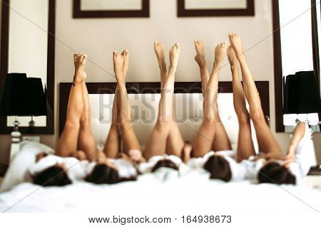 Cute legs of the bride and her girls