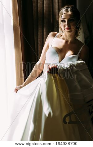 Bride in the underwear and white bridal dress