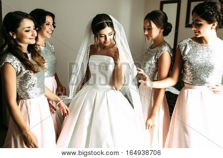 Bridesmaids and bride in the amazing dress