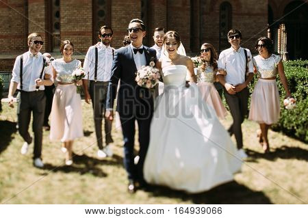 Wonderful just married couple and their friends behind